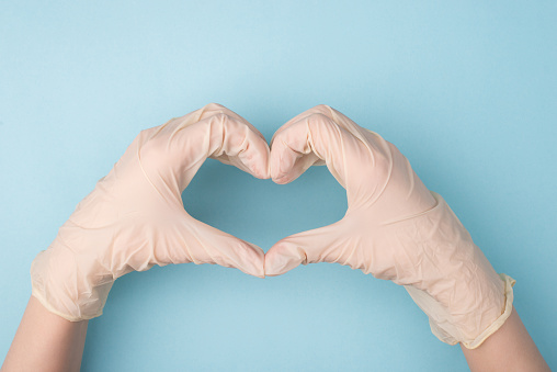 Save Life Concept Cropped Top Above Overhead Close Up Photo Of Hands Making Giving Shape Of Heart With Fingers Isolated Over Blue Background Stock Photo - Download Image Now