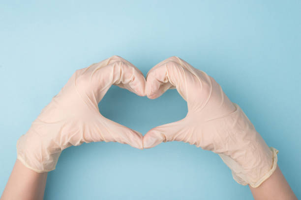 Save life concept. Cropped top above overhead close up photo of hands making giving shape of heart with fingers isolated over blue background Save life concept. Cropped top above overhead close up photo of hands making giving shape of heart with fingers isolated over blue background prevention stock pictures, royalty-free photos & images