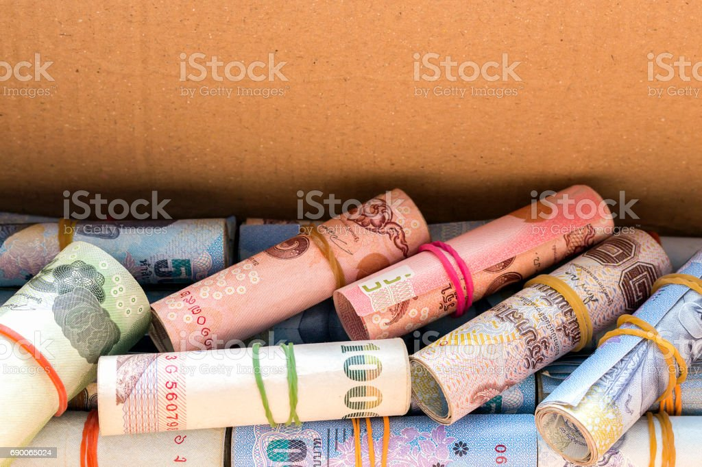 save money concept. Thai money in old paper box with over light in the background stock photo
