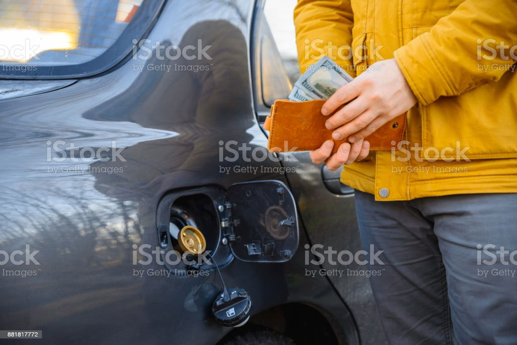 save money concept with LPG instead GAS stock photo