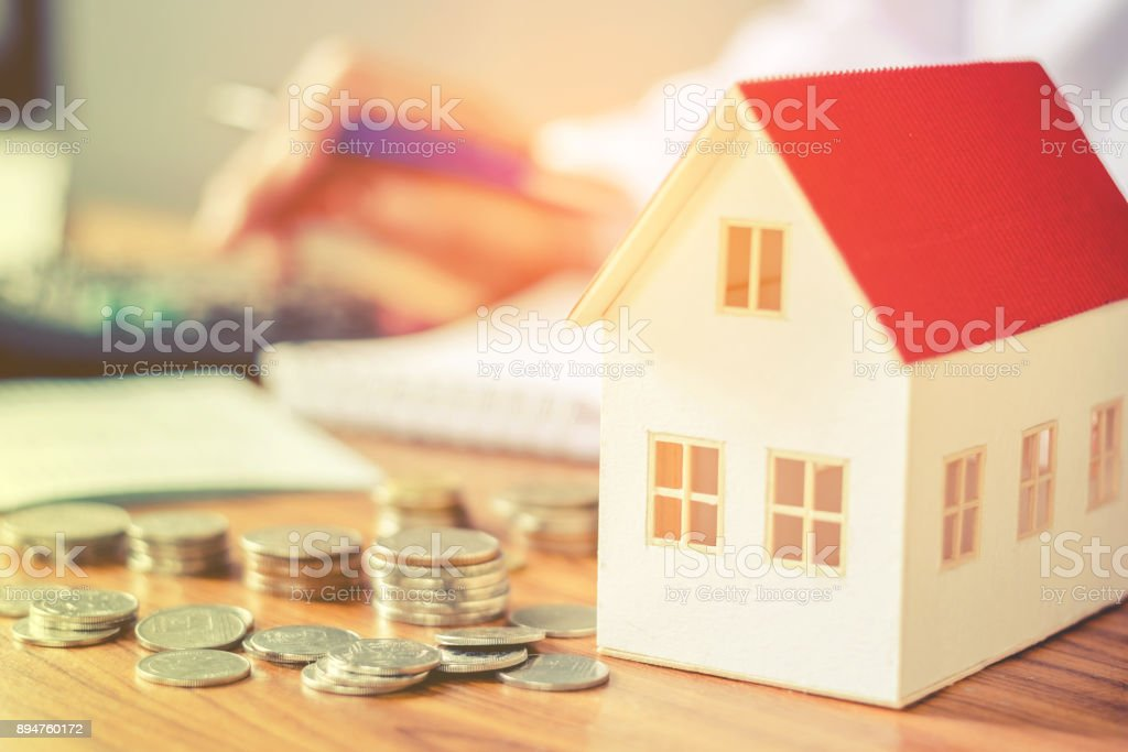 Save money for home cost concept stock photo