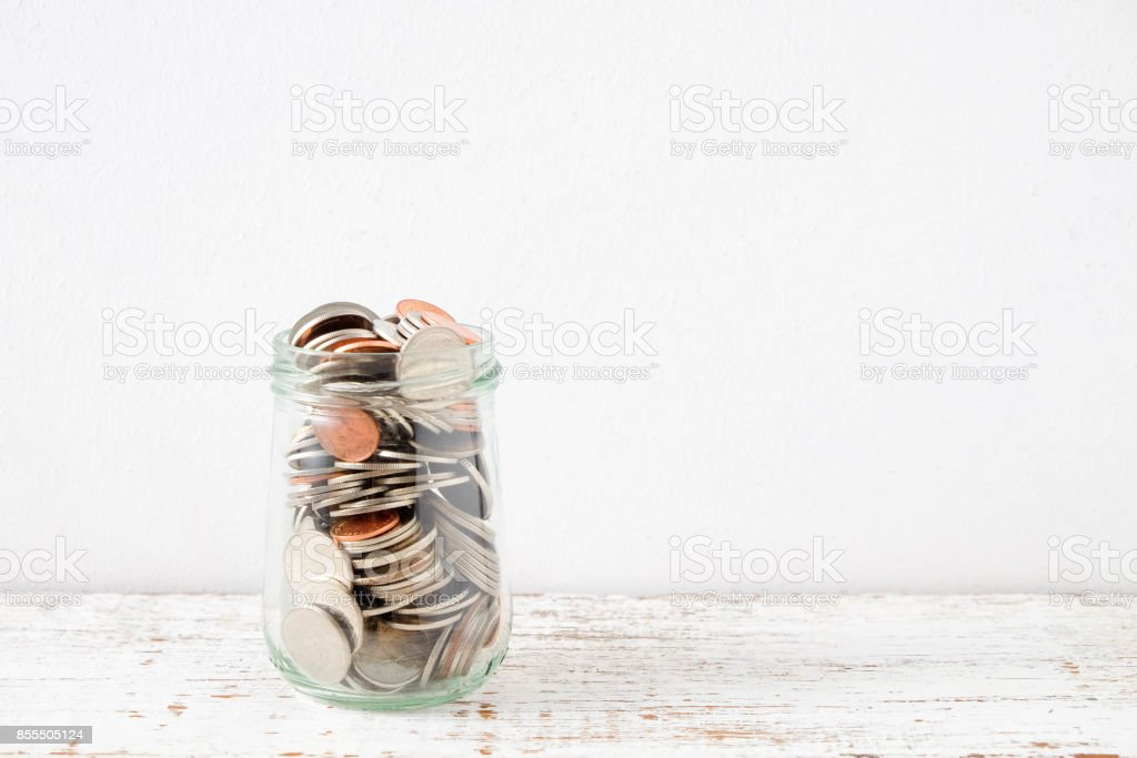 save money for investment concept coin baht thai in the glass jar stock photo