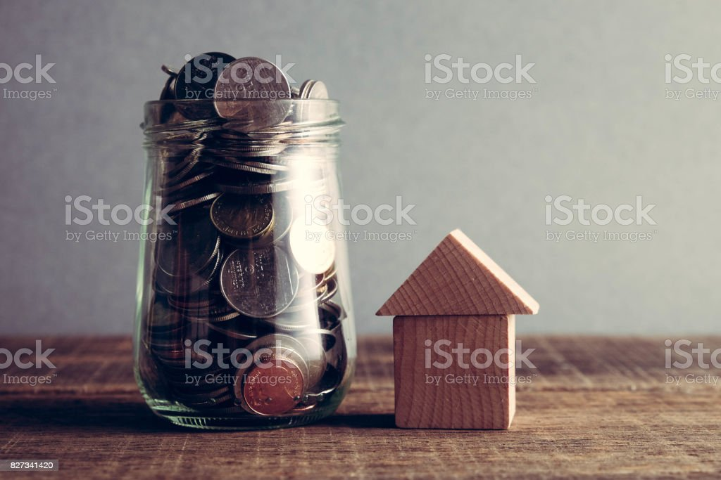 save money for investment mortgage concept by money house from a coins with filter effect retro vintage style stock photo