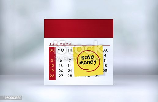 1170746979istockphoto Save Money Note paper on the calendar on the table 1160963559