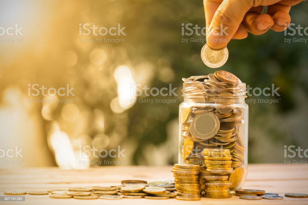 Save money with stack money coin stock photo