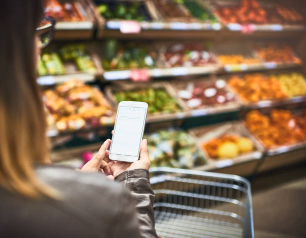 save paper, use a grocery list app - app store stock photos and pictures