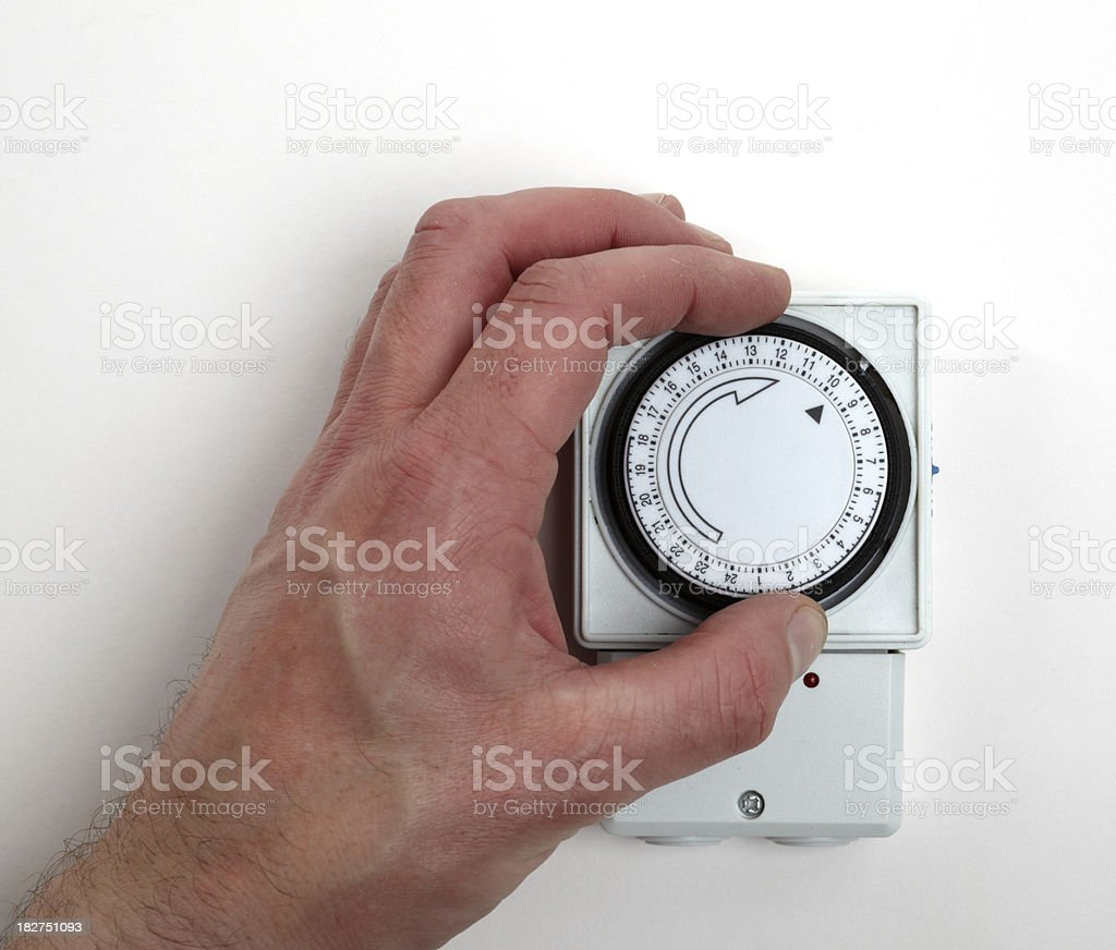Save power costs by adjusting heater timer stock photo