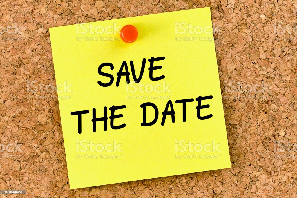 Save the date PostIt Note Pinned To Cork Board or corkboard stock photo