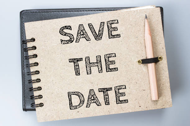 Save the date, Text message on brown Notebook / business concept stock photo