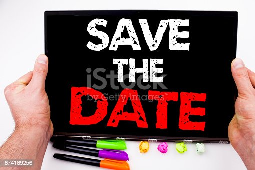 istock Save The Date text written on tablet, computer in the office with marker, pen, stationery. Business concept for Special Day and Greeting white background with copy space 874189256