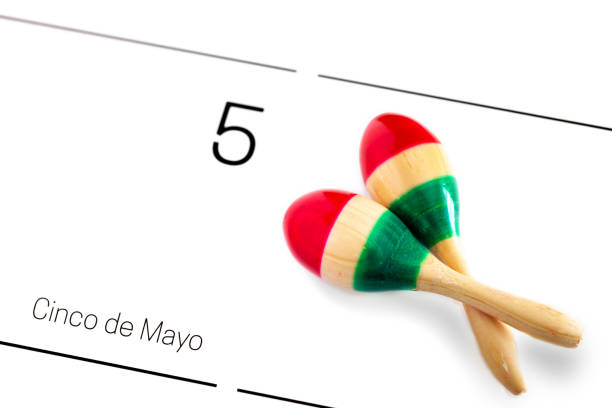 save the date white calendar for cinco de mayo, may 5th with maracas painted in the colors of the mexican flag/ cinco de mayo concept - cinco de mayo stock photos and pictures