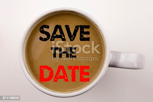 istock Save The Date Writing text in coffee in cup. Business concept for Special Day and Greeting on white background with copy space. Black text with red Date word. 874186840