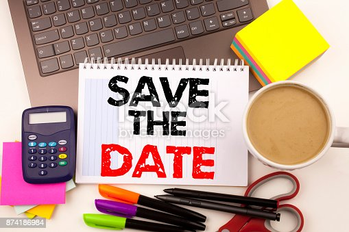 istock Save The Date writing text in the office with surroundings such as laptop, marker, pen, stationery, coffee. Business concept for Special Day and Greeting white background with copy space 874186984