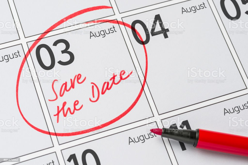 Save the Date written on a calendar - August 03 stock photo