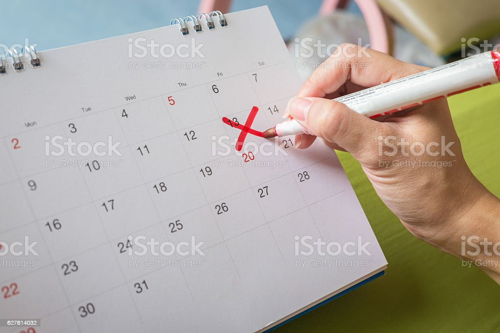 Save the Date written on a calendar Lucky number 13th stock photo