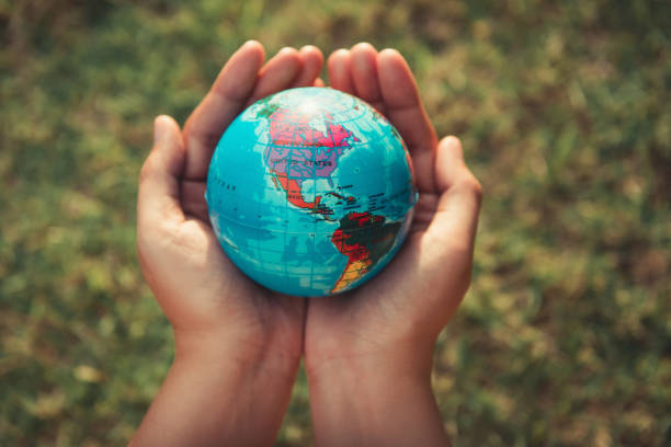 save the earth concept, woman hands is holding mockup the global on tree leave background - indumento sportivo protettivo foto e immagini stock