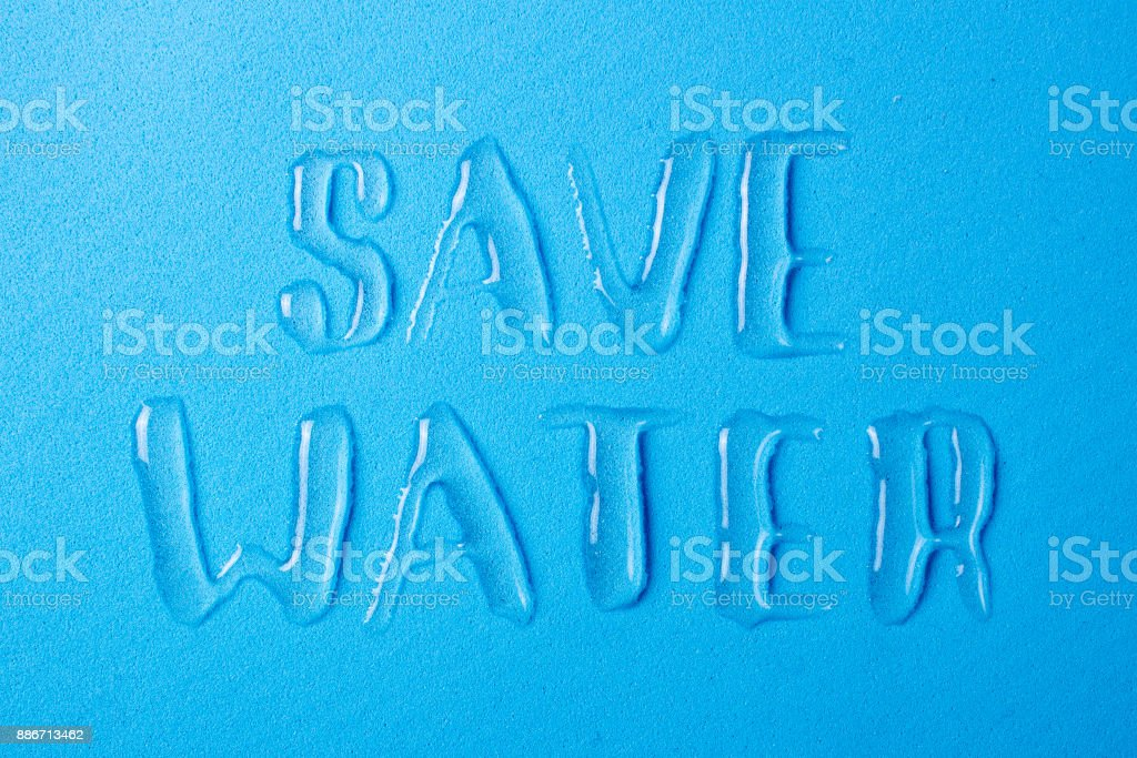 Save the water and save life on the planet. Letters from spilled water drops royalty-free stock photo
