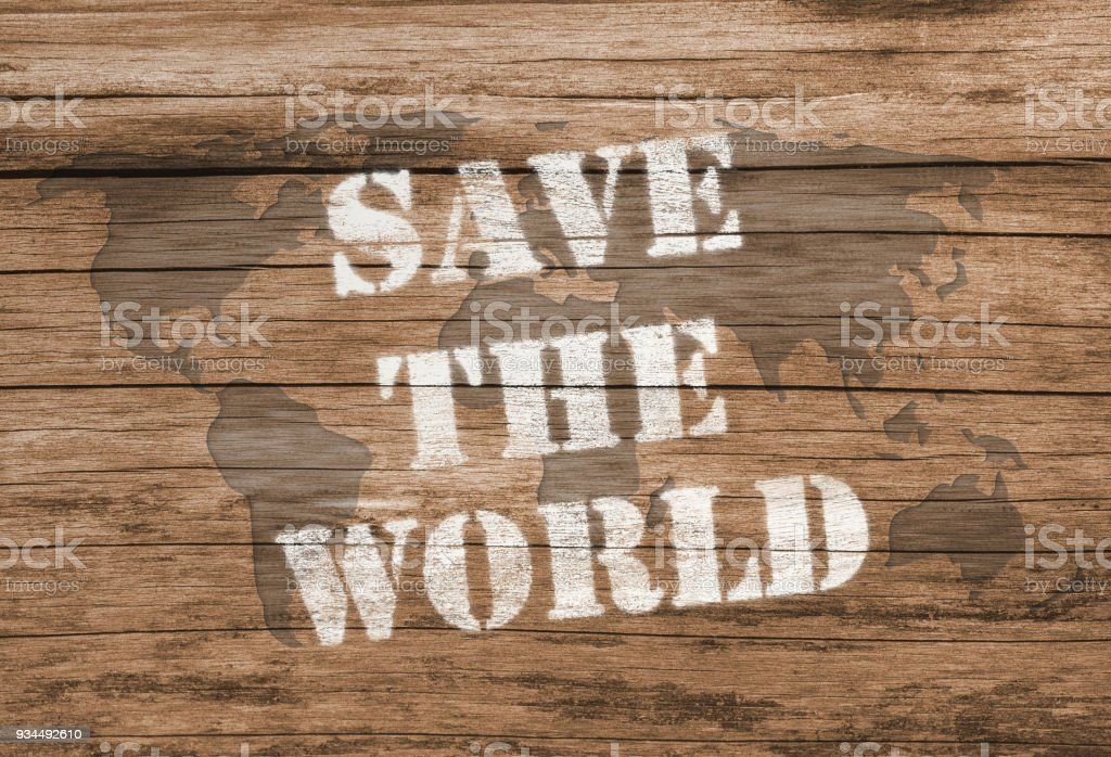 save the world chalk lettering on wooden background royalty free stock photo