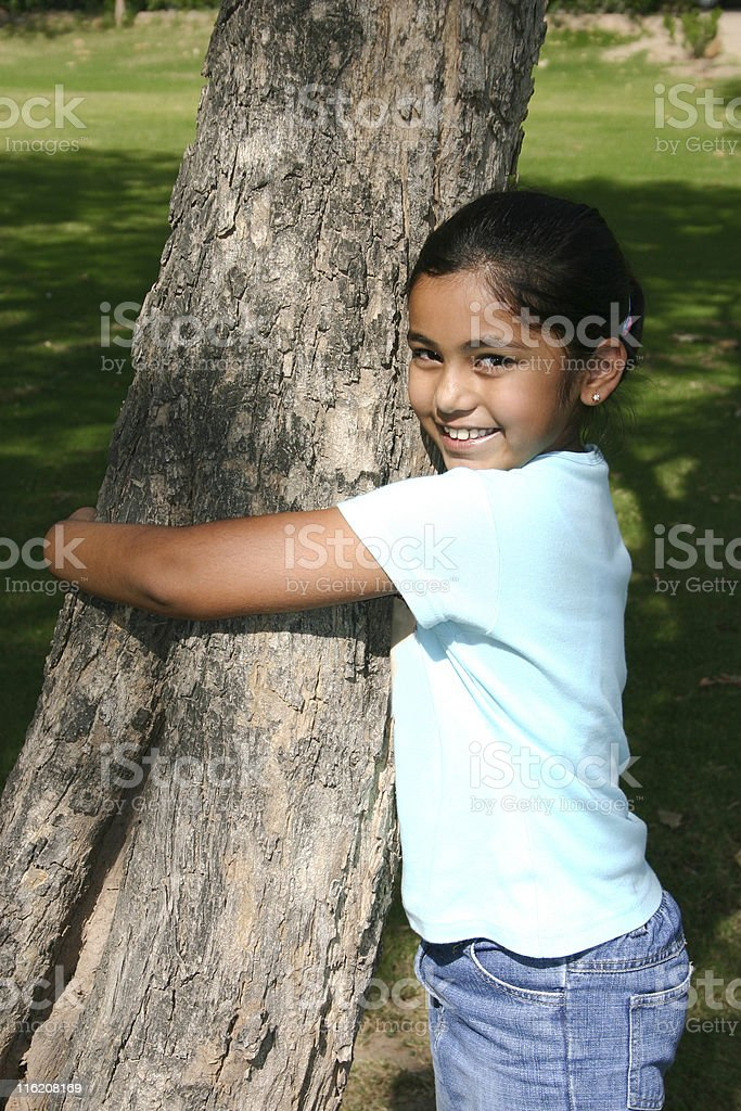 Save Trees Young Indian Girl saving a Tree royalty-free stock photo