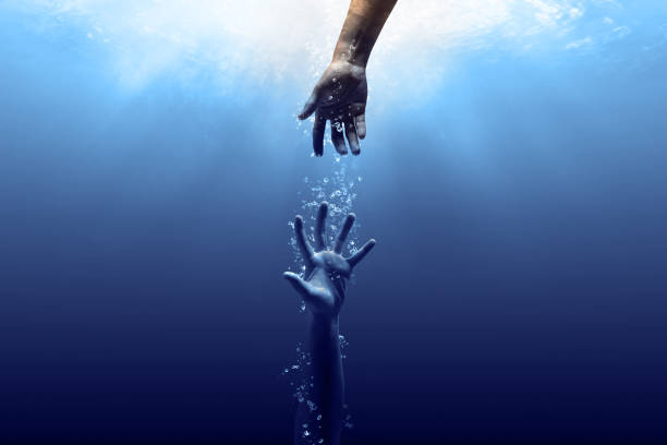 Save us out from the darkness hand drown in the water looking for help a helping hand stock pictures, royalty-free photos & images