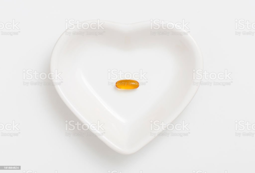 Royalty Free Fish Oil Heart Shape Vitamin Pill Pill Pictures Images