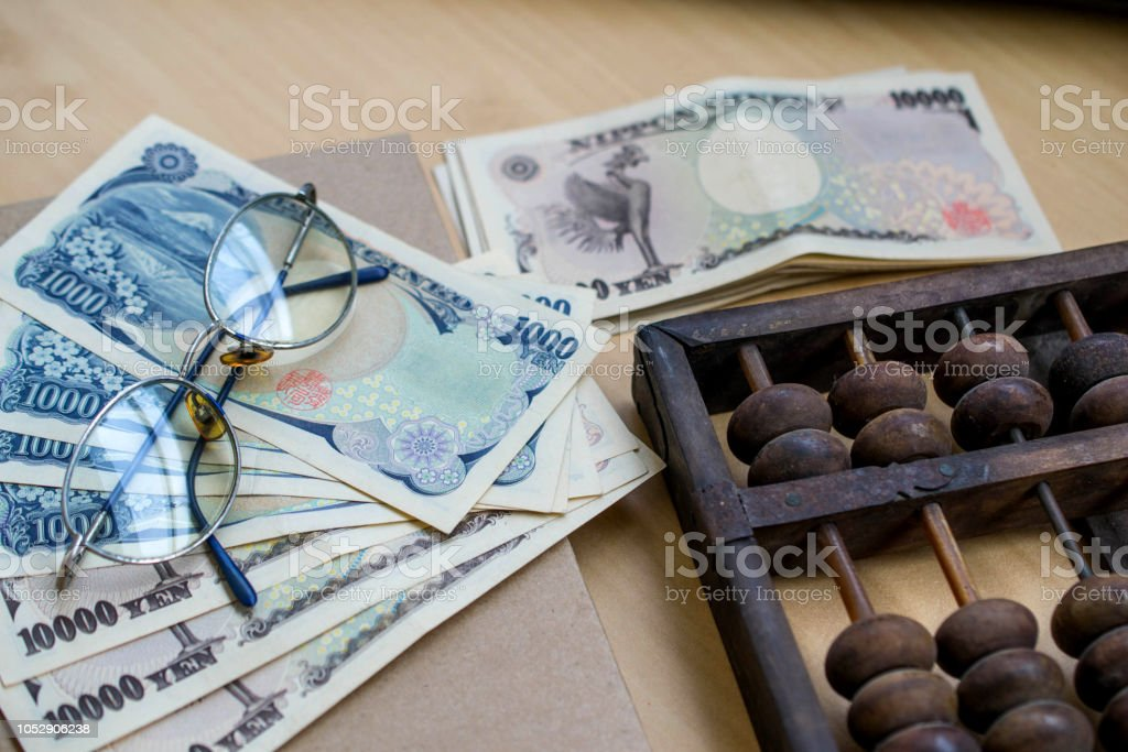 saving account and money concept using an abacus for calculation stock photo
