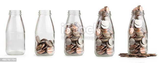 istock Saving coin in glass bottle 490787754
