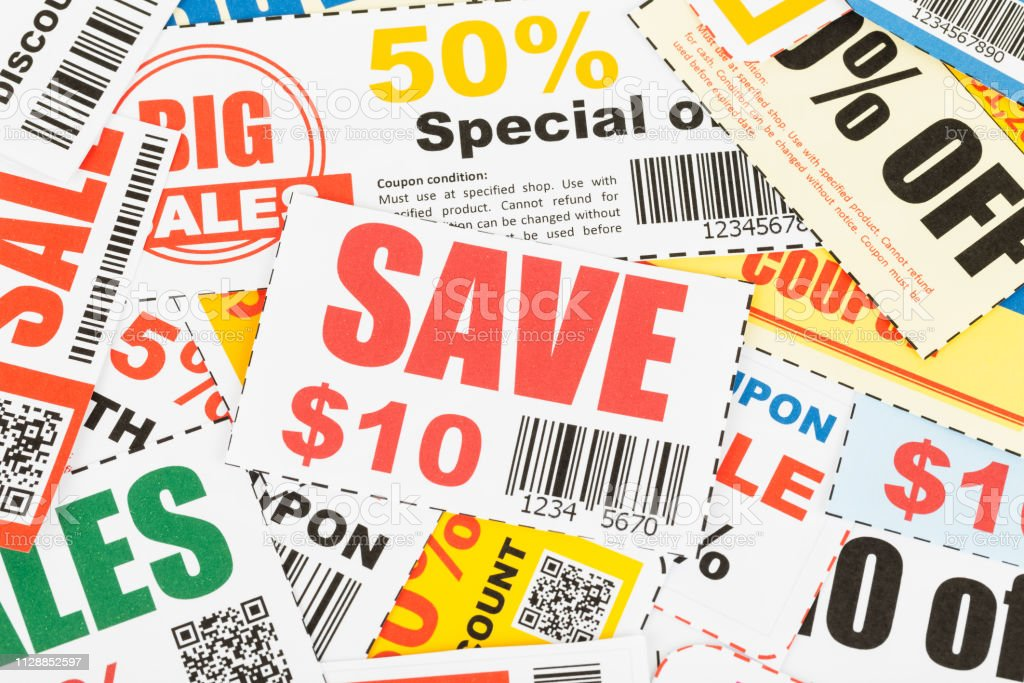 Saving coupon voucher with scissors, coupons are mock-up