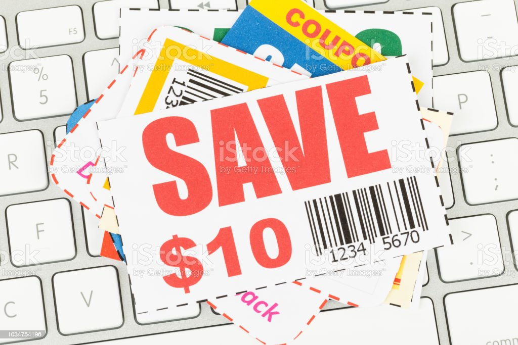 Saving discount coupon voucher on keyboard, coupons are mock-up