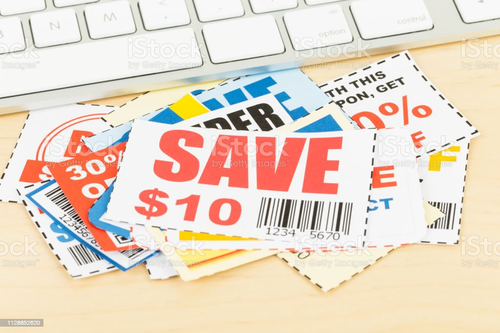 Saving discount coupon voucher with keyboard, coupons are mock-up