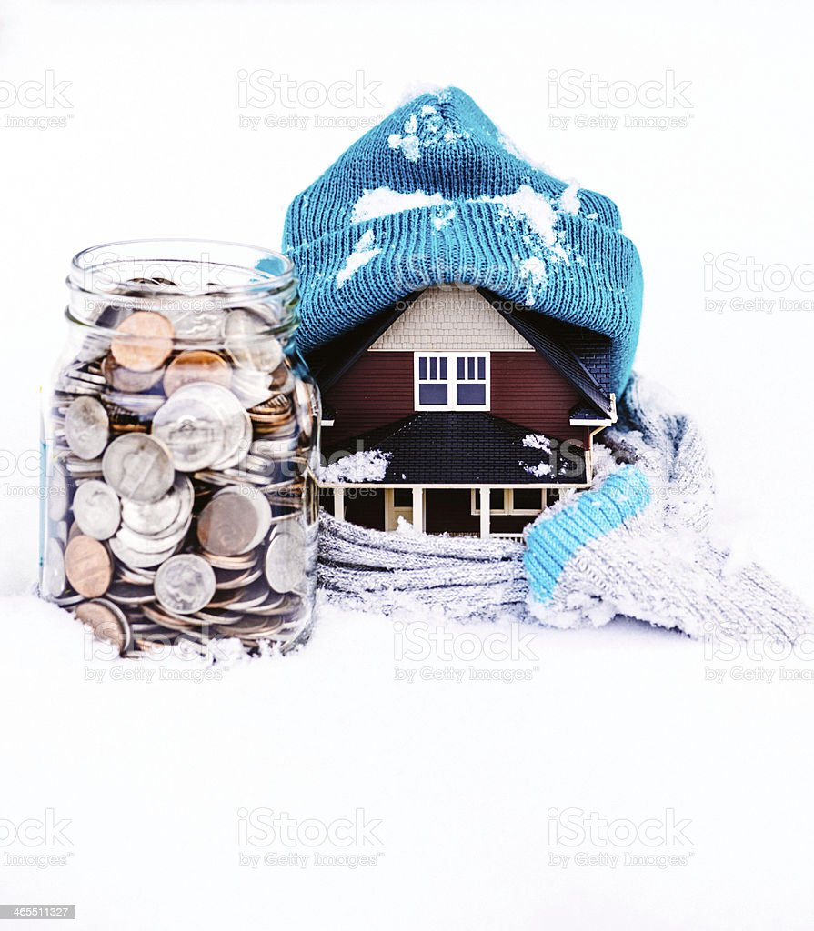 Saving for Winter Housing Costs stock photo