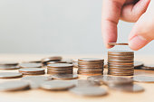 istock Saving money and investing is growing growth wealthy and sustainable for the future concept, Hand of male or female putting coin stack step growing growth financial 876393564