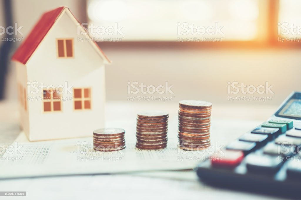 Saving money concept calculator cost for Home stock photo