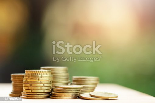 istock Saving money concept preset by money coins stacked on each other in different positions for growing your business. Credit financial concept 1157569804
