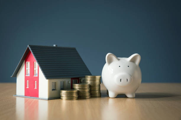 Saving money for house concept with white piggy bank Buying, Finance, Finance and Economy, Home Finances, Home Improvement salé morocco stock pictures, royalty-free photos & images