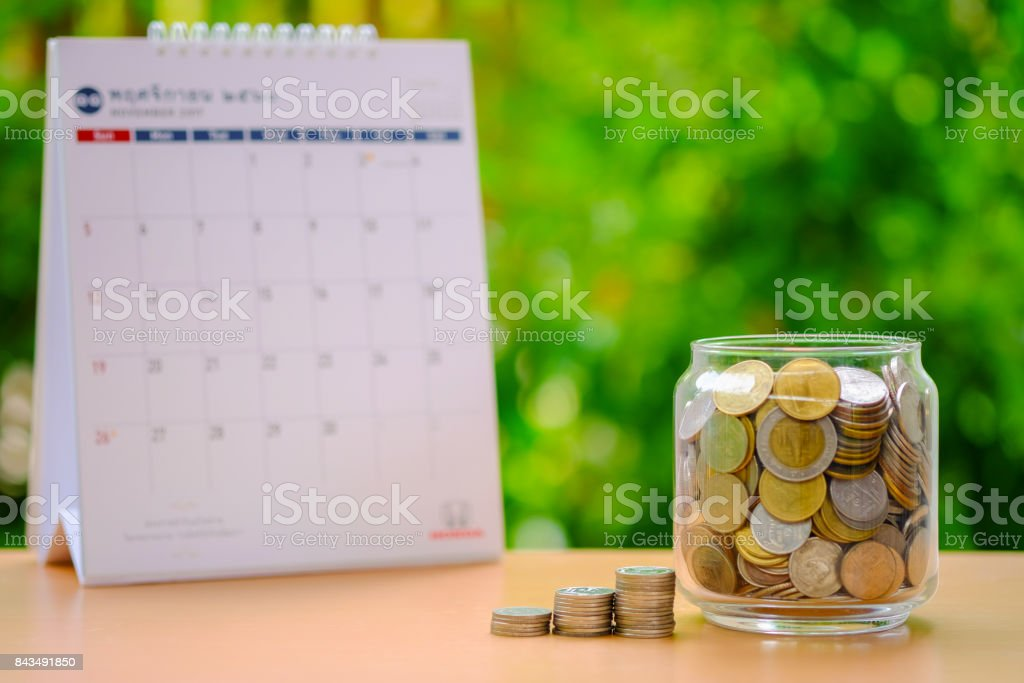 Saving money for travel in holiday concept stock photo