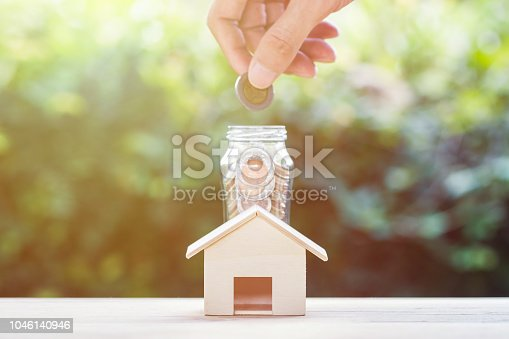 1048402108istockphoto Saving money, home loan, mortgage, a property investment for future concept. 1046140946