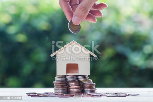 1048402108istockphoto Saving money, home loan, mortgage, a property investment for future concept 1046140968