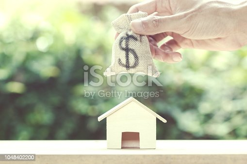 1048402108istockphoto Saving money, home loan, mortgage, a property investment for future concept. 1048402200