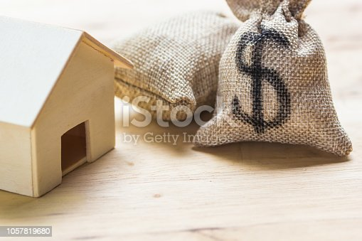1048402108istockphoto Saving money, home loan, mortgage, a property investment for future concept. 1057819680