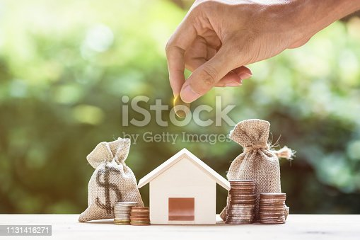 istock Saving money, home loan, mortgage, a property investment for future concept. 1131416271