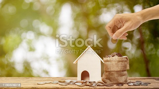 istock Saving money, home loan, mortgage, a property investment for future concept. 1150326018