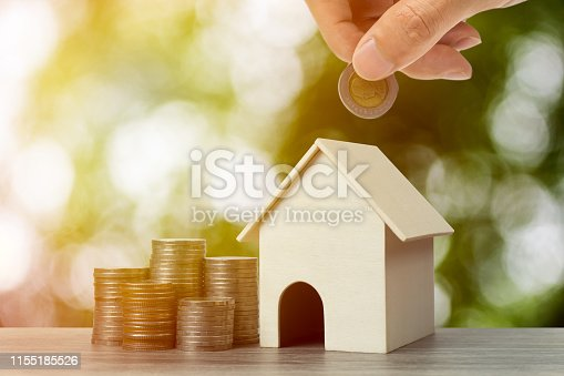 958039576istockphoto Saving money, home loan, mortgage, a property investment for future concept. 1155185526