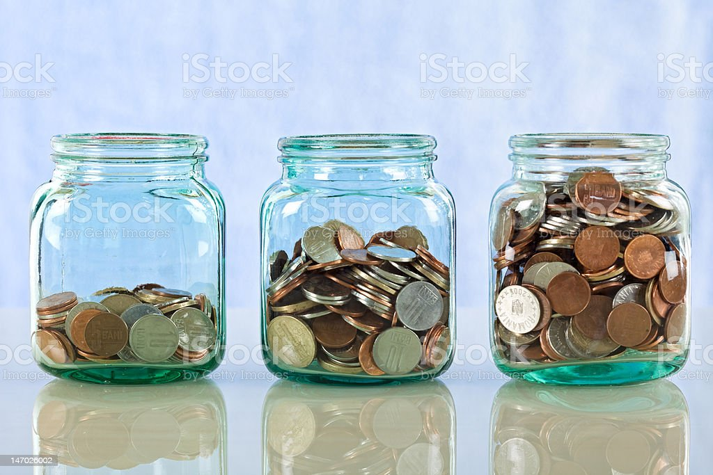Saving money in old jars royalty-free stock photo