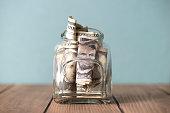 US dollars in the jar.