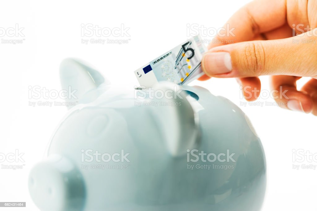 Saving money with a piggy bank, five Euro royalty-free stock photo