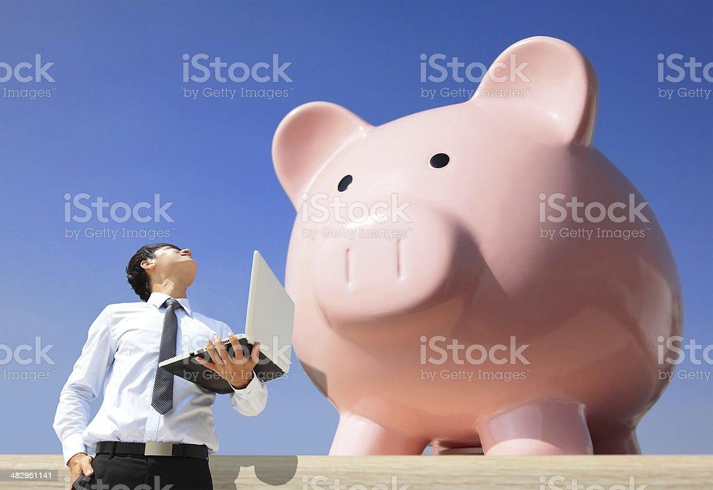 Saving Money with my piggy bank stock photo