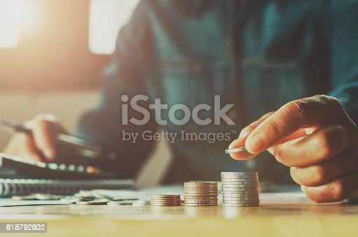 istock Saving money woman hand putting coin stack concept business finance 818792802