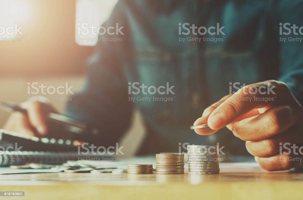 Saving money woman hand putting coin stack concept business finance stock photo