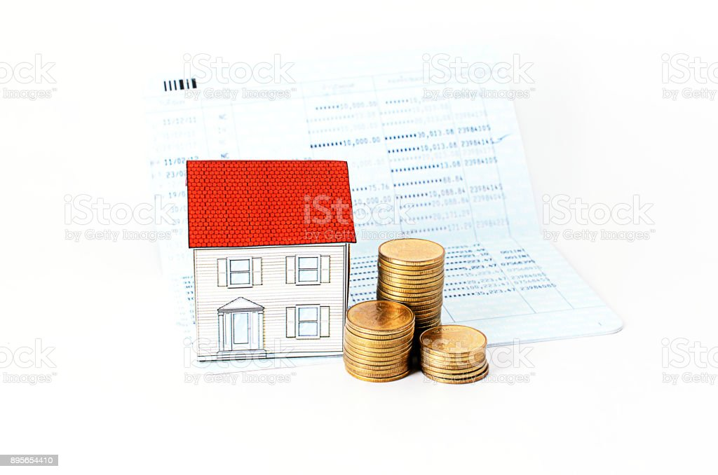 Saving plan concept with paper house and coins stack stock photo